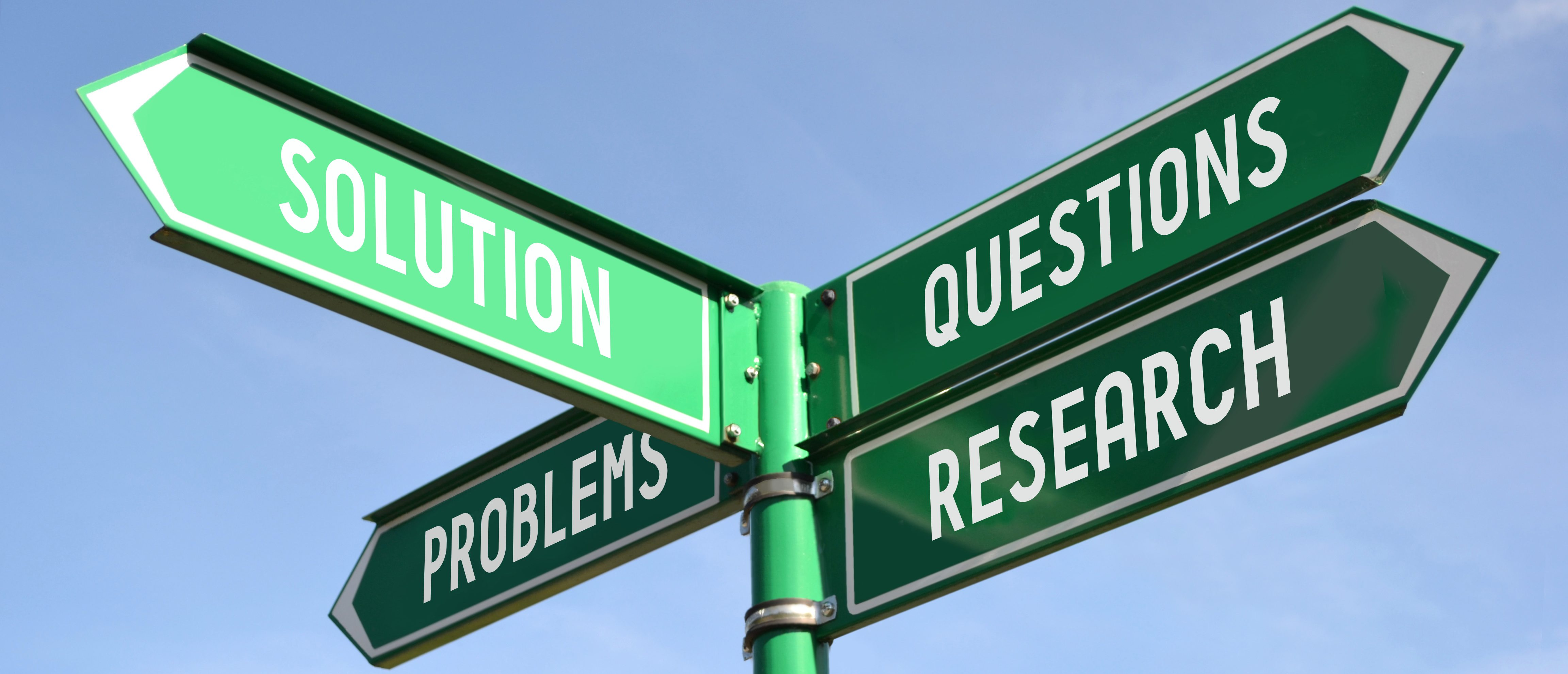 Cannabis Studies: Street sign showing arrows to questions, research, problems, and solutions